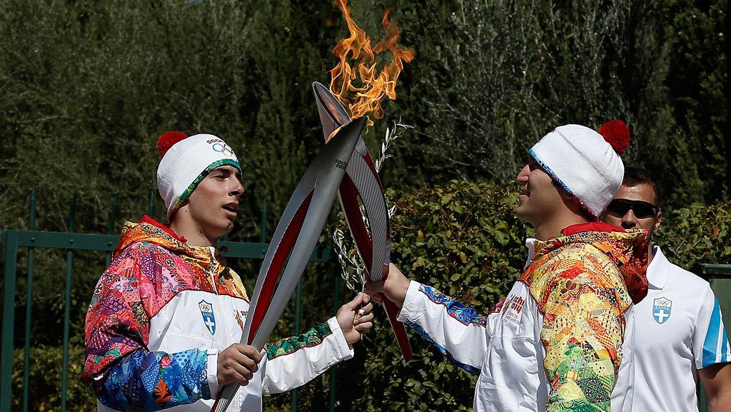 Олимпийский огонь.  Факелоносцы